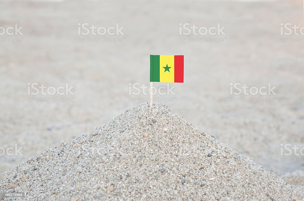 Senegal Flag on the Beach stock photo