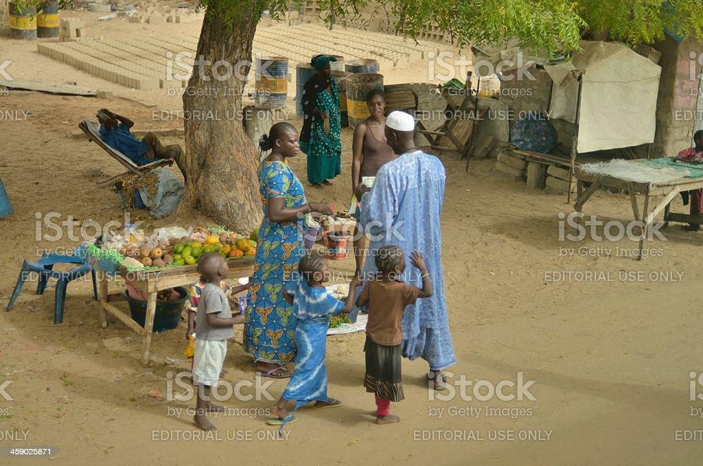 Senegalese Food Vendor And Children stock photo