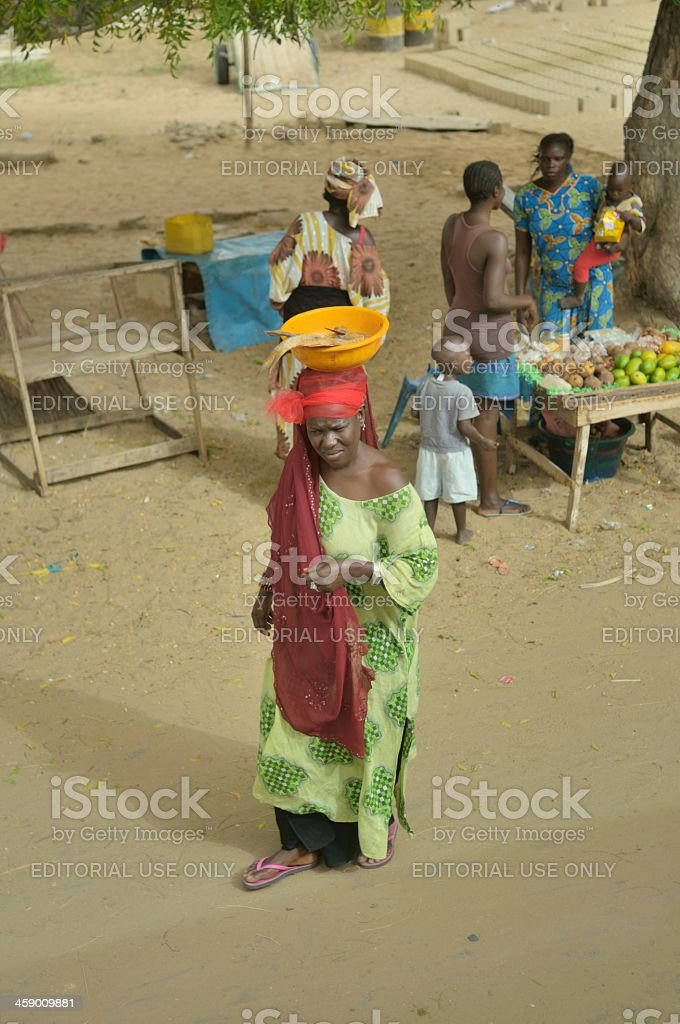 Senegalese Woman Carrying Fish On Head stock photo