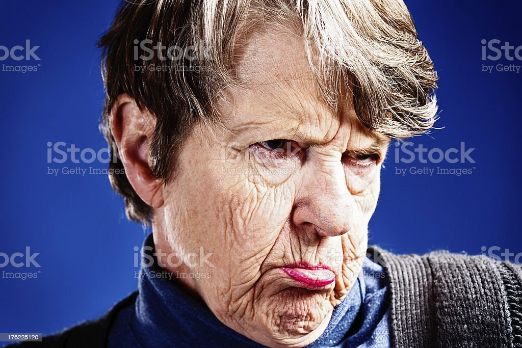 Senile old woman frowns and pouts royalty-free stock photo