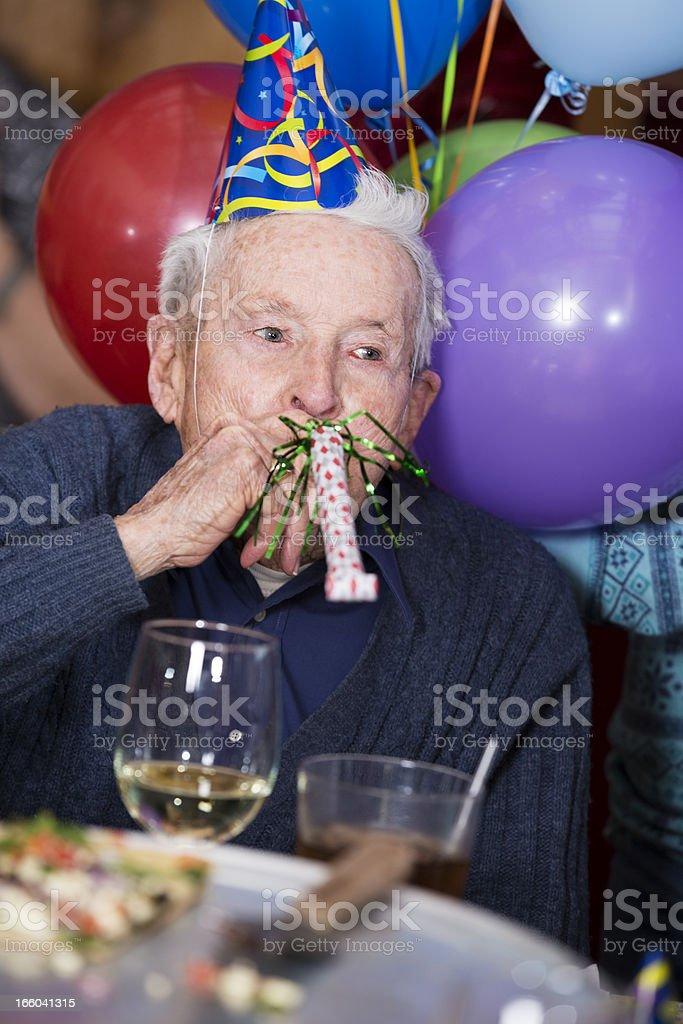 Senior 90-year old man enoying birthday party at pizza restaurant royalty-free stock photo
