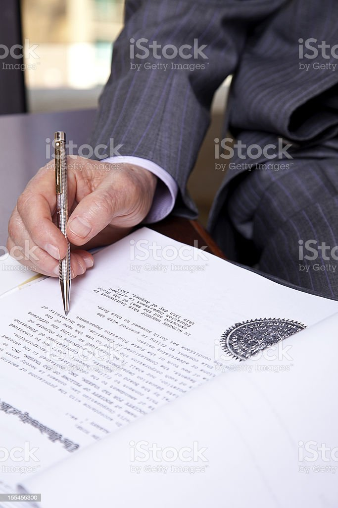 Senior About to Sign stock photo