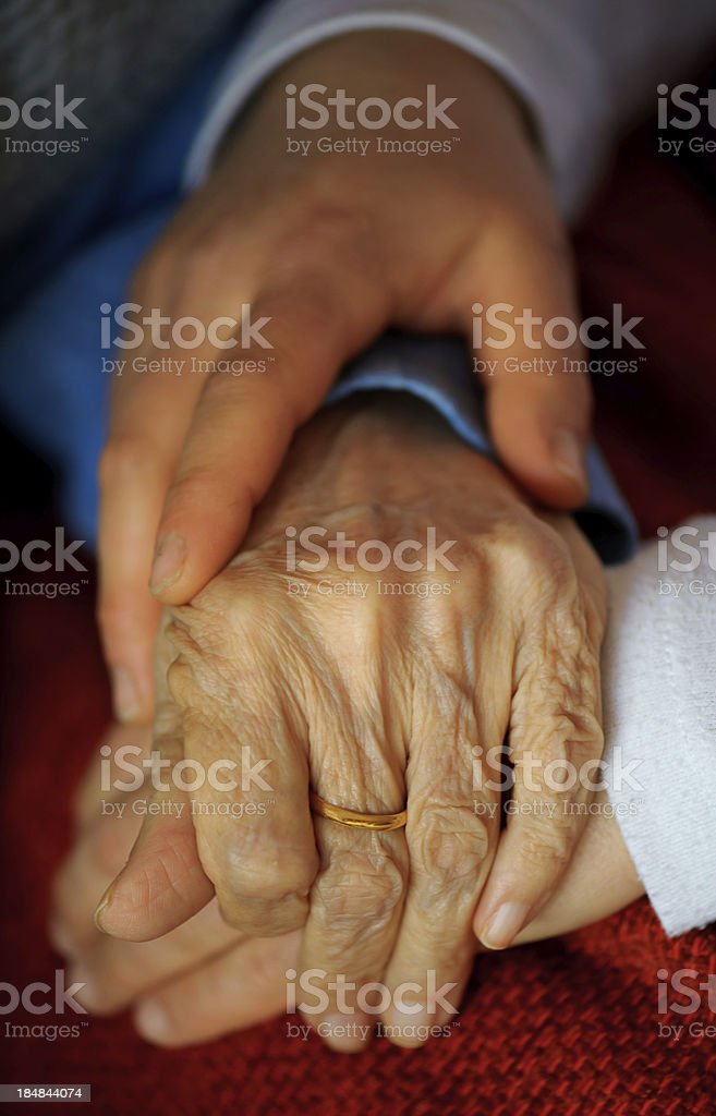 Senior Adult and young woman hands royalty-free stock photo