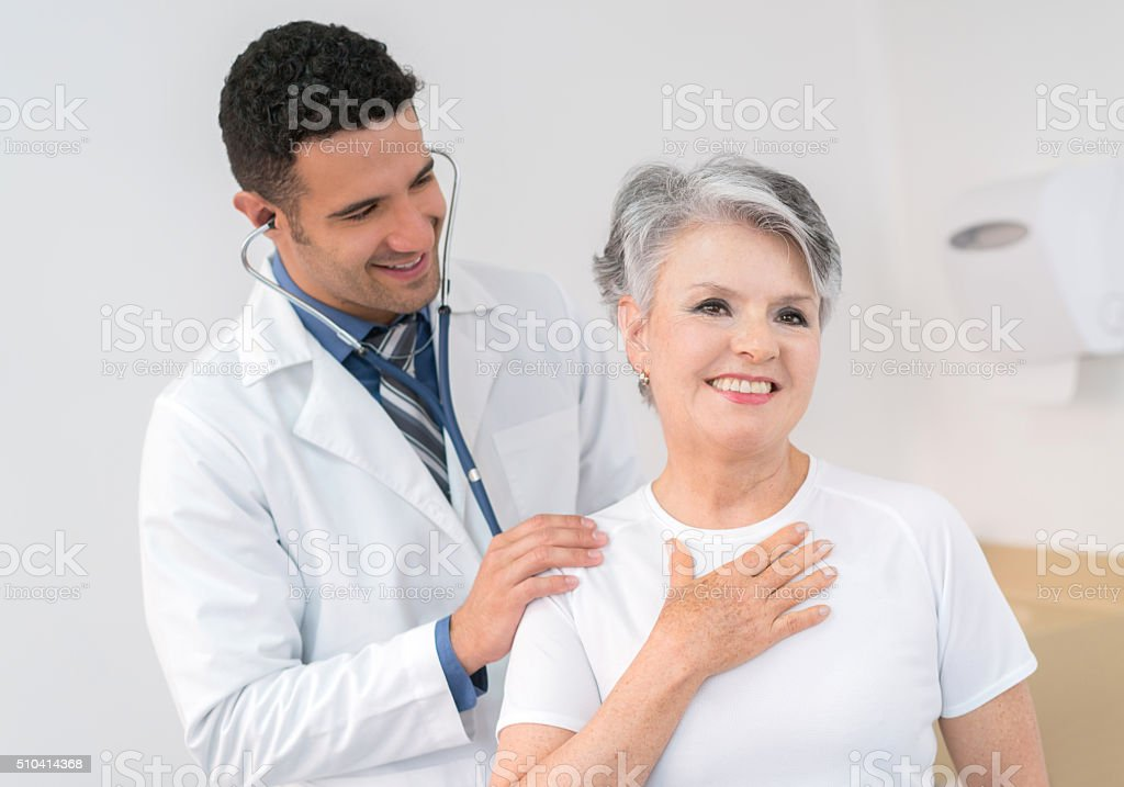 Senior adult at the doctor stock photo