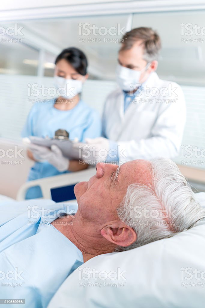 Senior adult at the ICU stock photo