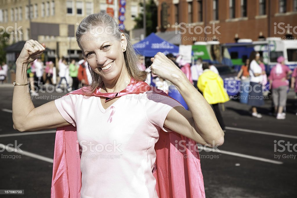 Senior Adult Cancer Survivor with Cape at Awareness Rally royalty-free stock photo