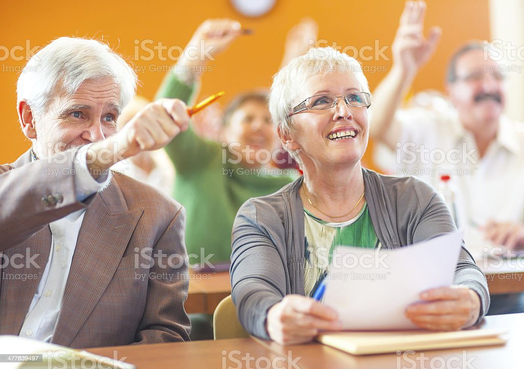 Senior adult education and support group in a meeting stock photo