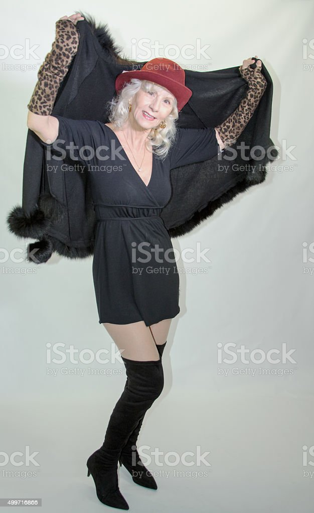 Senior Adult Female Donning Her Cape stock photo