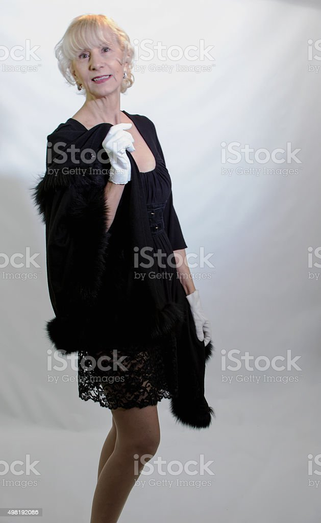 Senior Adult Female With Fur Trimmed Cape stock photo