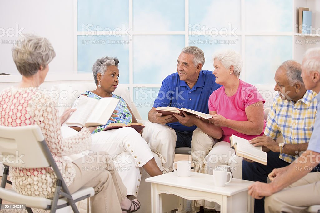 Senior adult friends, couples during bible study group. stock photo