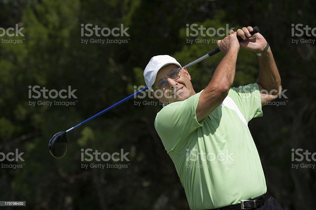 senior adult male folder teeing off royalty-free stock photo