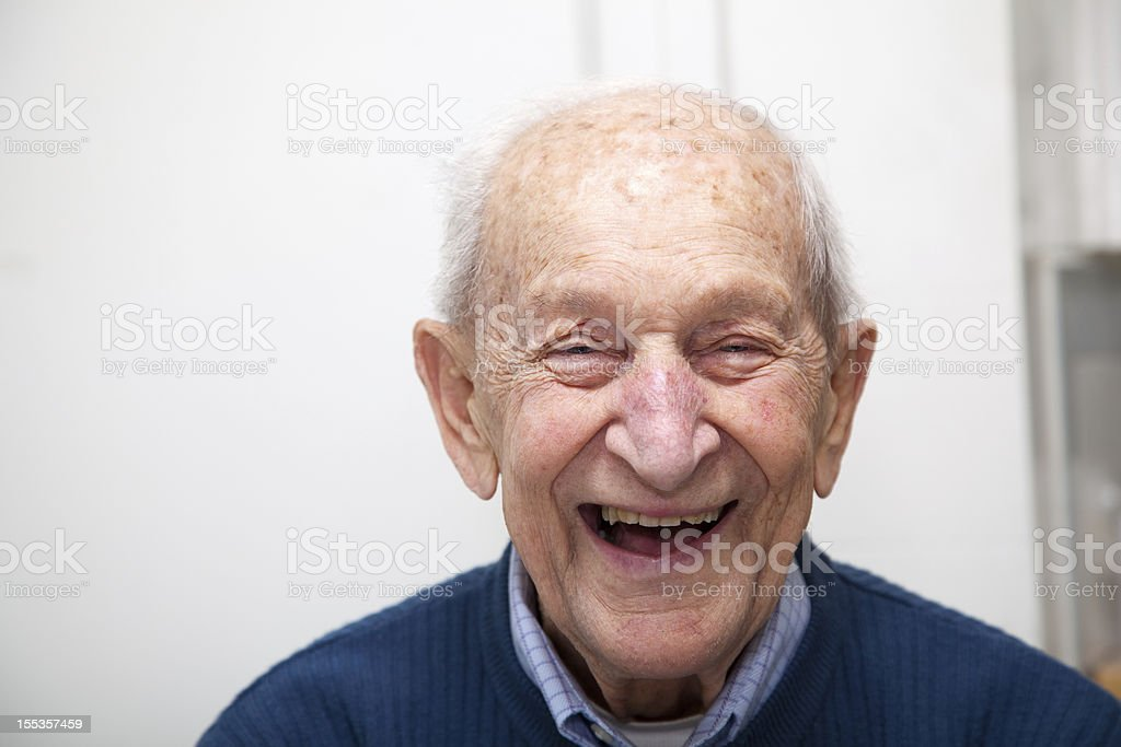 Senior adult male laughing portrait; he is 90 years old stock photo