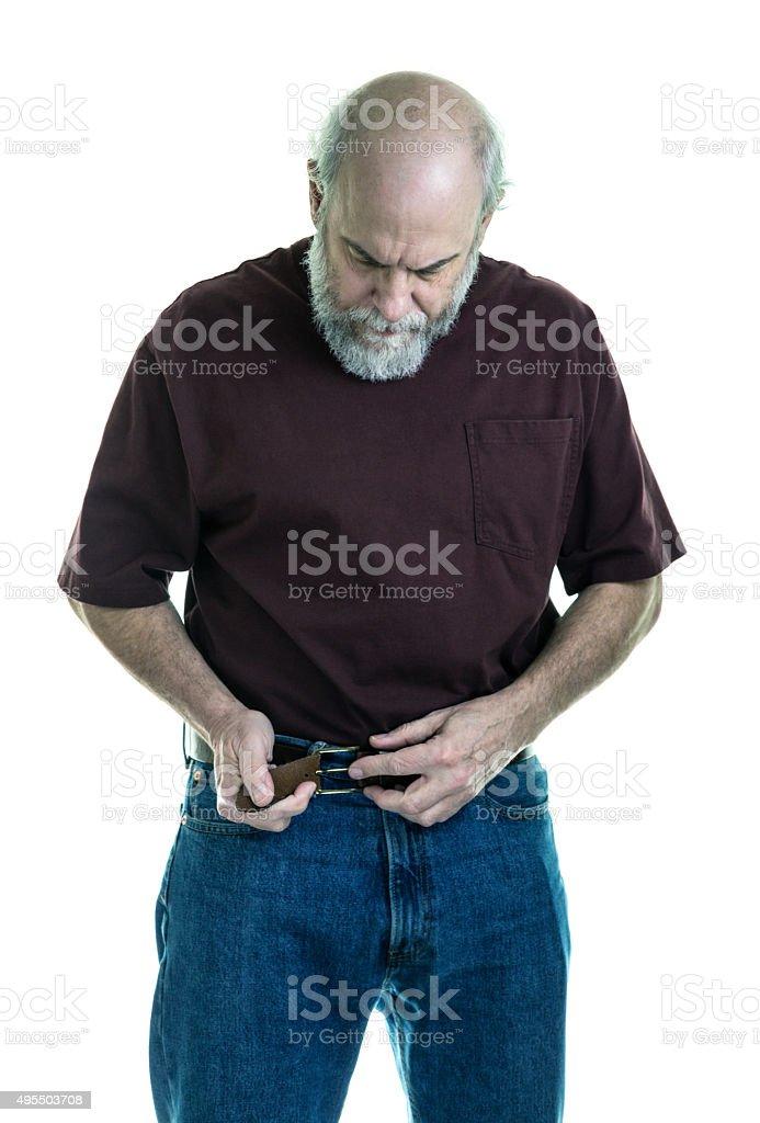Senior Adult Man Buckling Belt Getting Dressed stock photo