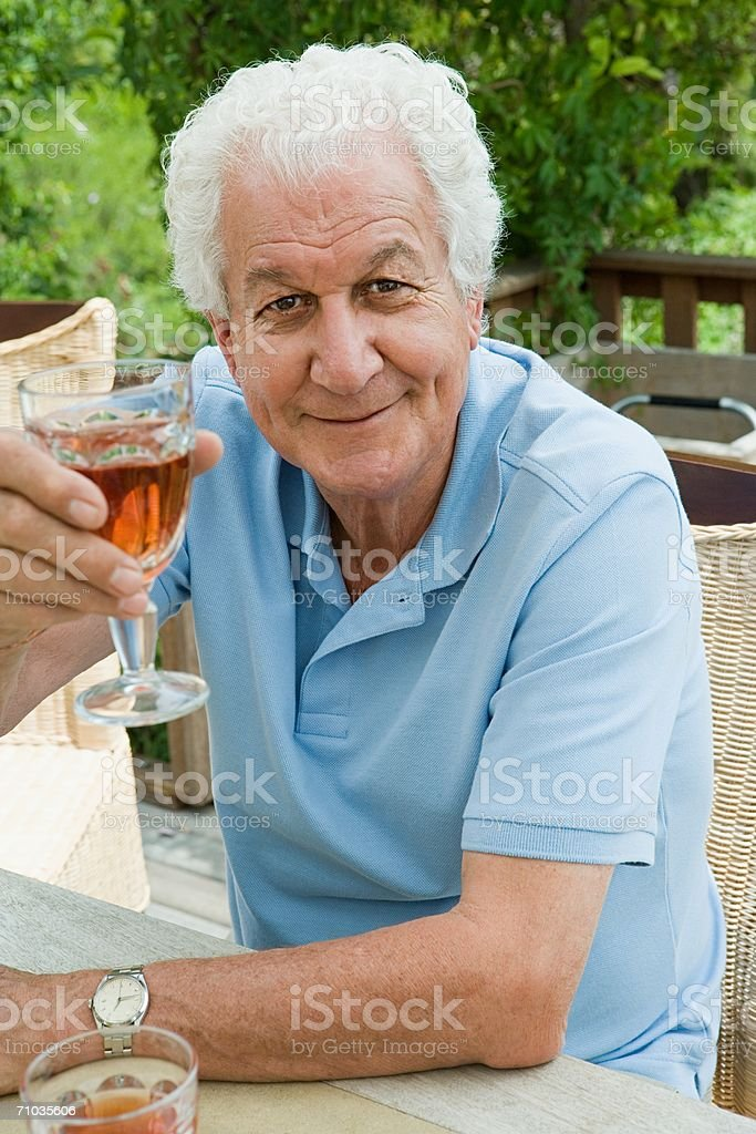 Senior adult man drinking a toast royalty-free stock photo