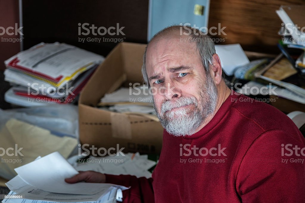 Senior Adult Man Hoarder In Messy Office Room stock photo