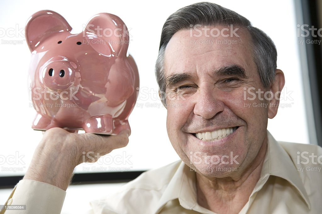 Senior Adult Man Holding a Piggy Bank royalty-free stock photo