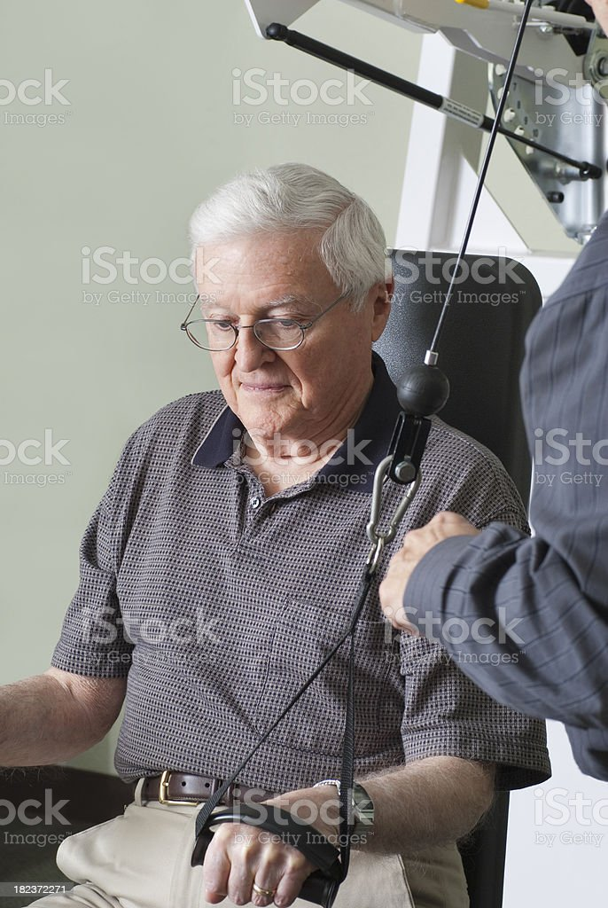 Senior Man Learning Arm Exercise - Physical Therapy Series stock photo