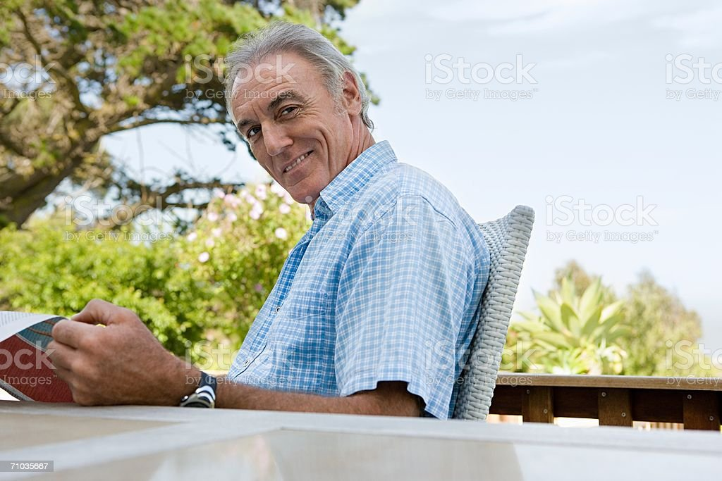 Senior adult man reading the newspaper royalty-free stock photo