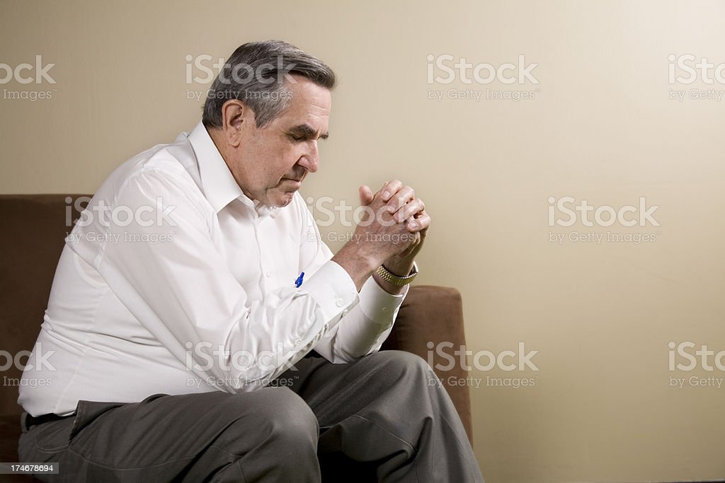 Senior Adult Man Sitting and Praying, With Copy Space royalty-free stock photo