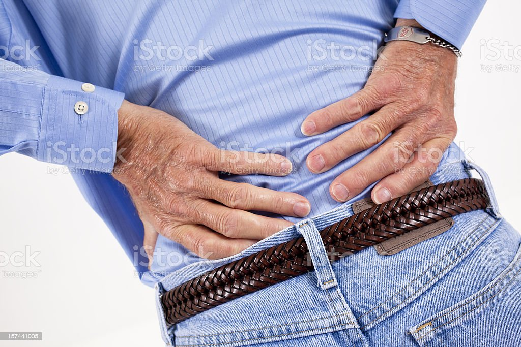Senior adult man with back pain. Backache. Hands. royalty-free stock photo
