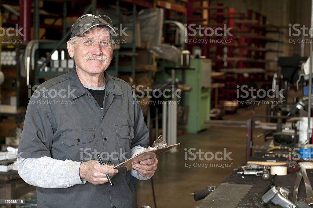 Senior Adult Manufacturing Employee stock photo