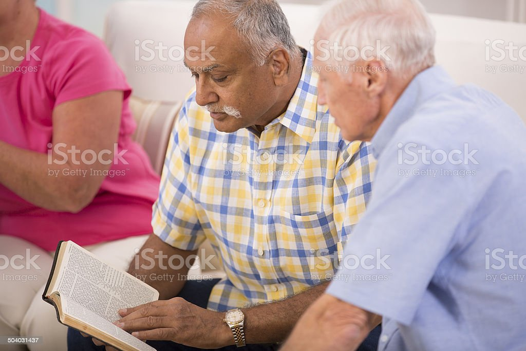 Senior adult men during bible study group. stock photo