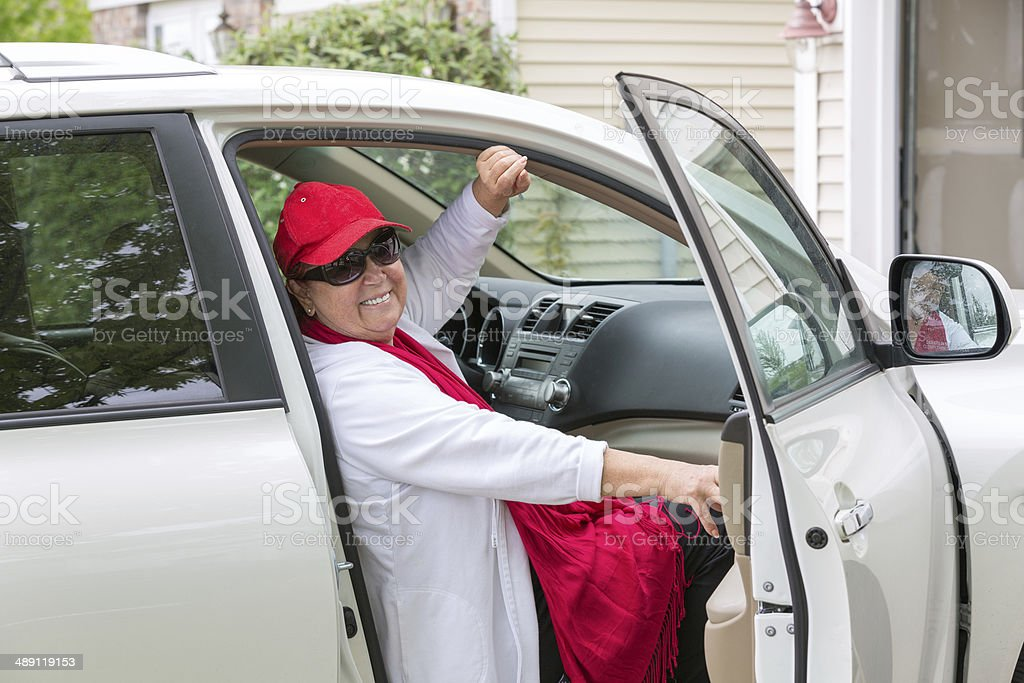 Senior Adult on the Cars Passenger seat ready for Trip stock photo