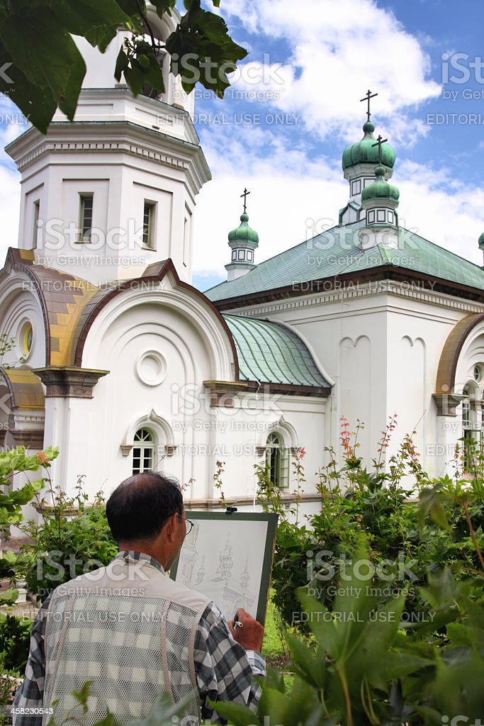 Senior adult picturing Hakodate Russian Orthodox Church stock photo