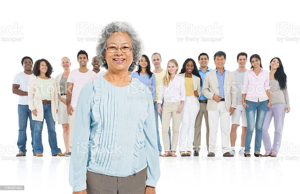 Senior adult standing out from crowd royalty-free stock photo