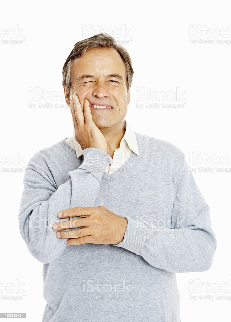 Senior adult suffering from a toothache against white royalty-free stock photo