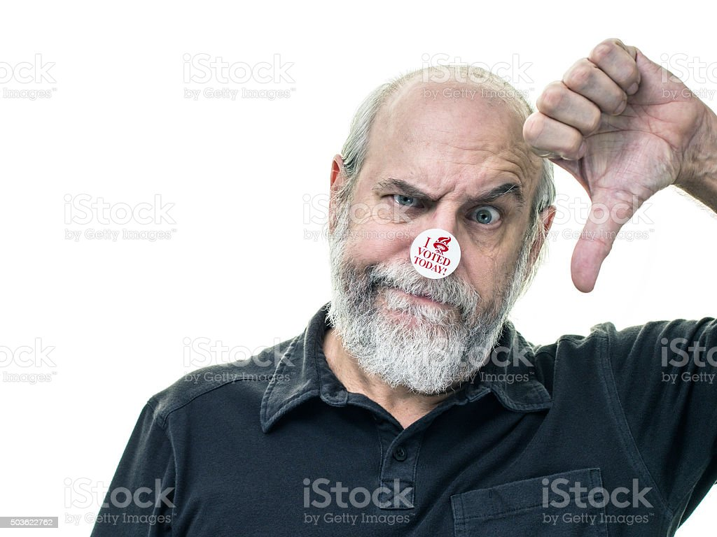 Senior Adult Voter Thumbs Down Negative Hand Gesture stock photo