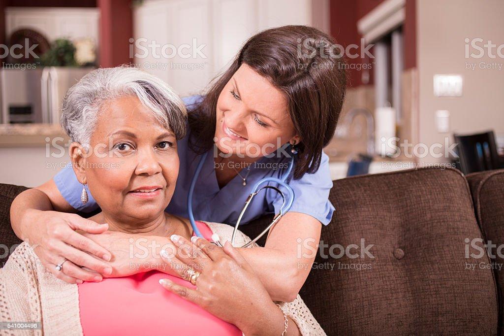 Wheelchair-bound African descent, female senior adult enjoys the...