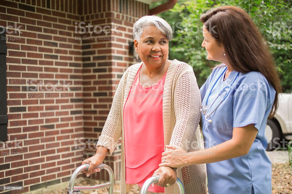African descent, female senior adult enjoys the outdoors with her...