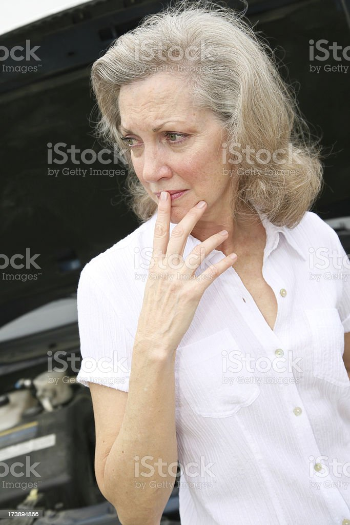Senior Adult Woman Concerned About Her Car Trouble royalty-free stock photo