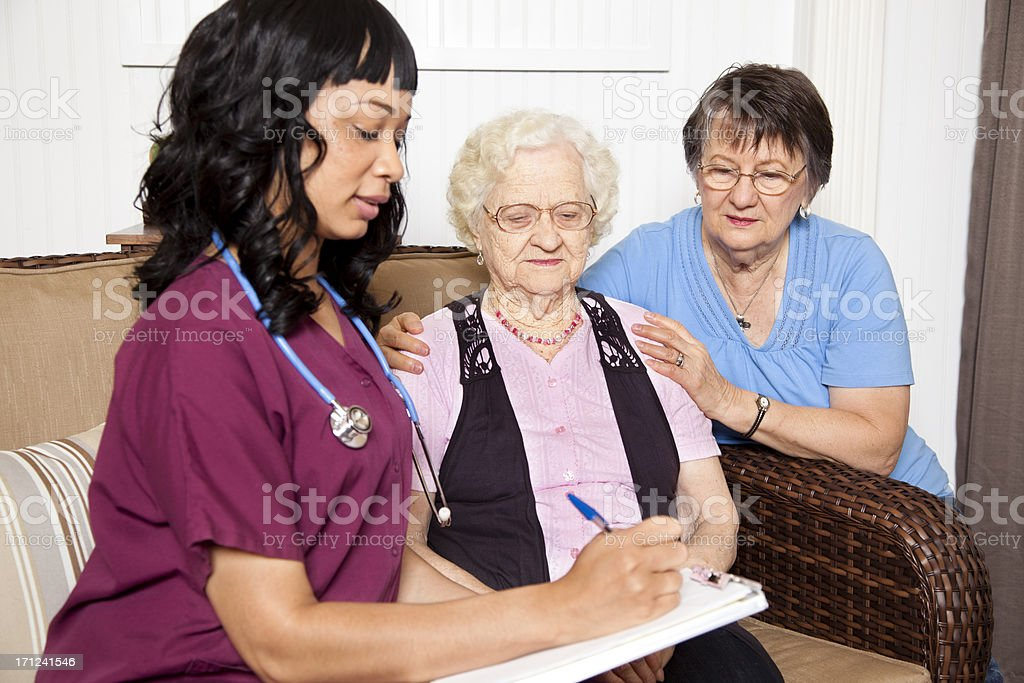 Senior adult woman. Daughter and nurse. Nursing home, assisted living. royalty-free stock photo