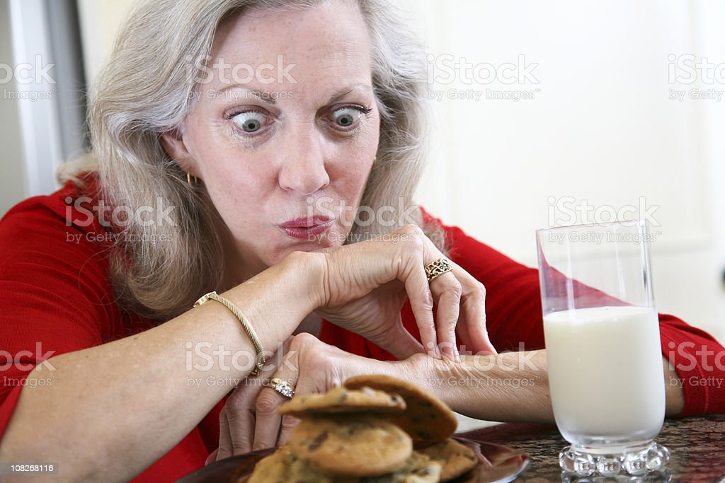 Senior Adult Woman Drooling Over Cookies and Milk royalty-free stock photo