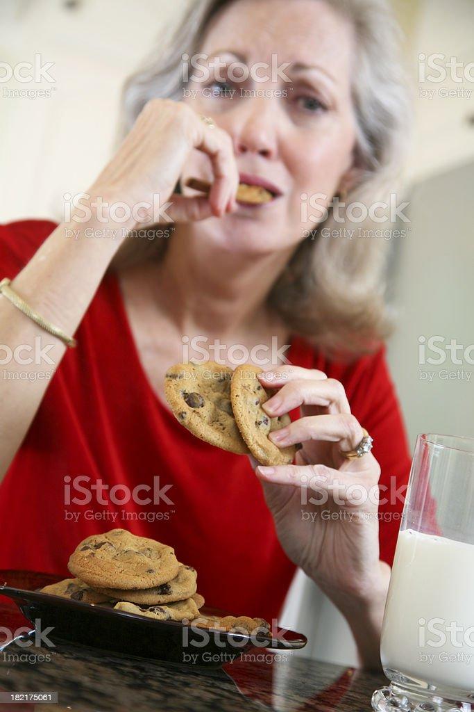 Senior Adult Woman Enjoying Her Cookies and Milk stock photo