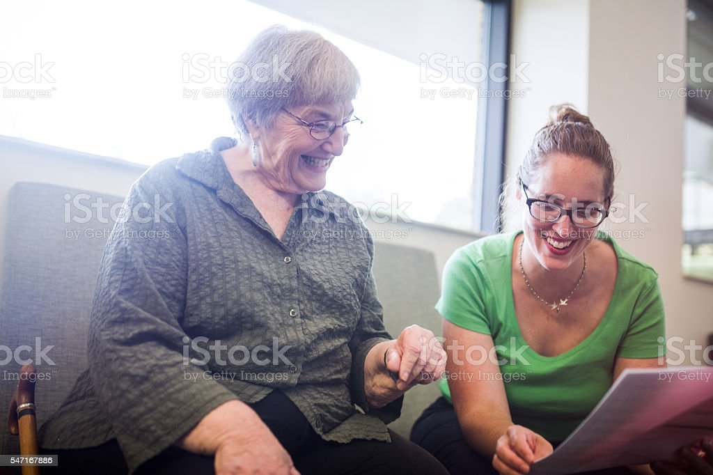 Senior Adult Woman Filling Out Paperwork stock photo