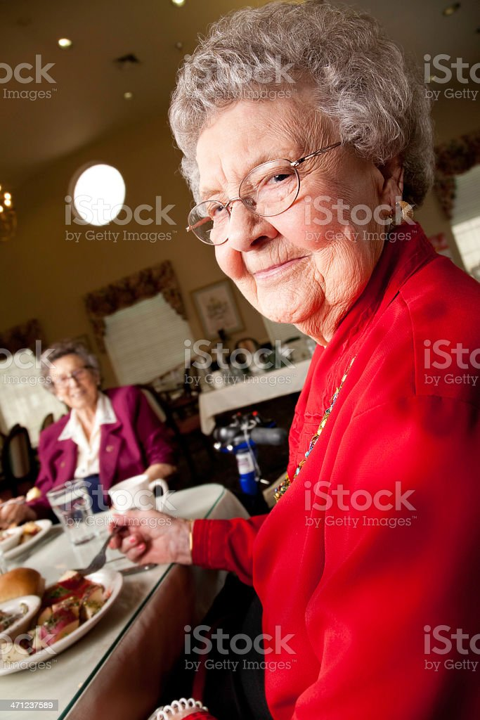 Senior Adult Woman Having Dinner in the Dining Hall royalty-free stock photo