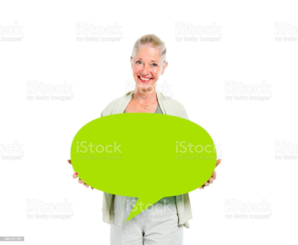 Senior Adult Woman Holding Green Speech Bubble stock photo