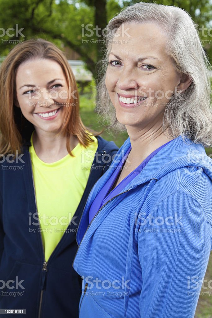 Senior Adult Woman Outside With Younger Friend royalty-free stock photo