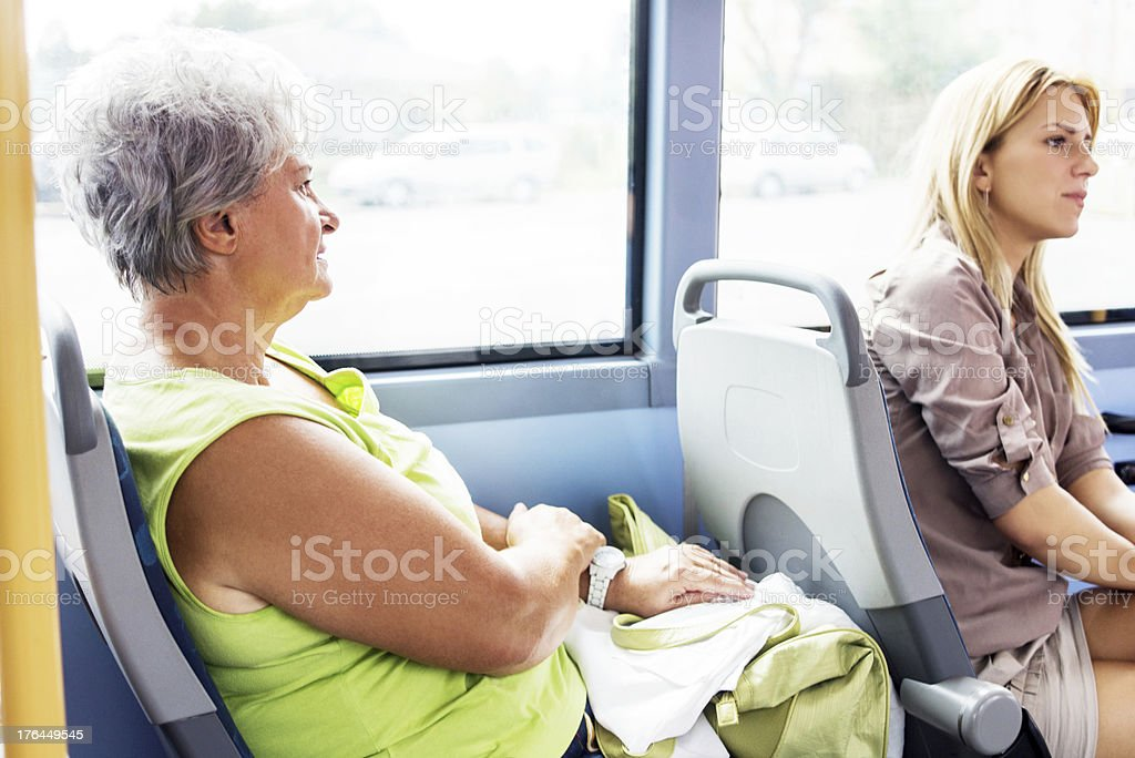 Senior adult woman travelling by bus. royalty-free stock photo