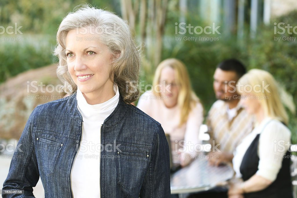 Senior Adult Woman With Business Team Planning Behind Her royalty-free stock photo
