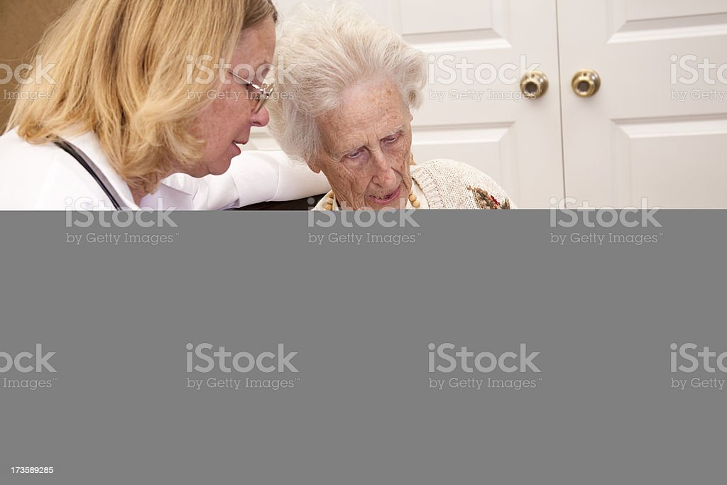 Senior adult woman with doctor and family members. Daughter. Consultation. royalty-free stock photo