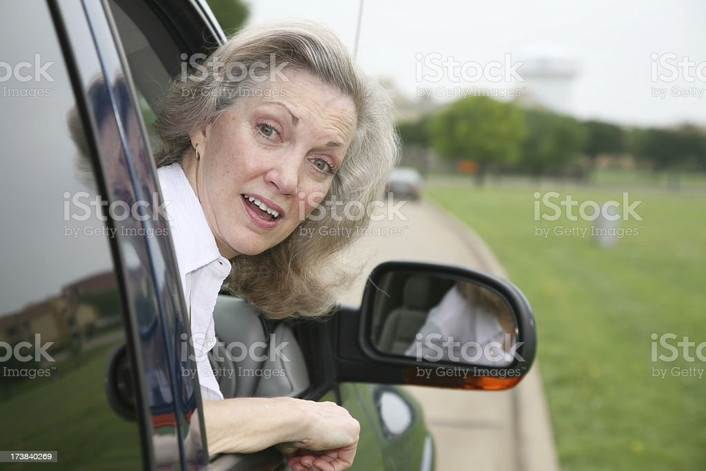 Senior Adult Woman With Surprise Look Out of Car Window royalty-free stock photo