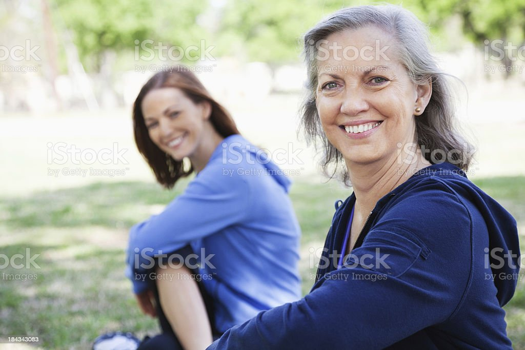 Senior Adult Woman Working Out at Park With Friend royalty-free stock photo