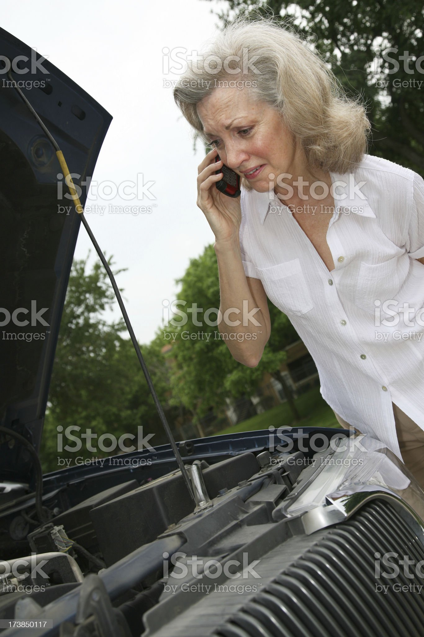 Senior Adult Woman Worried about Her Broken Down Car royalty-free stock photo