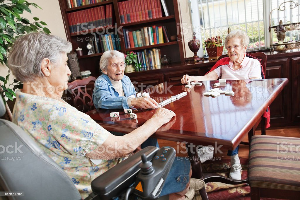 Senior Adult Women Playing Dominos Together royalty-free stock photo
