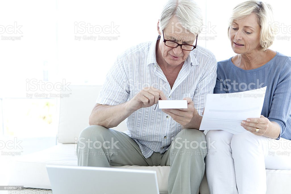 Senior adults doing home finances stock photo