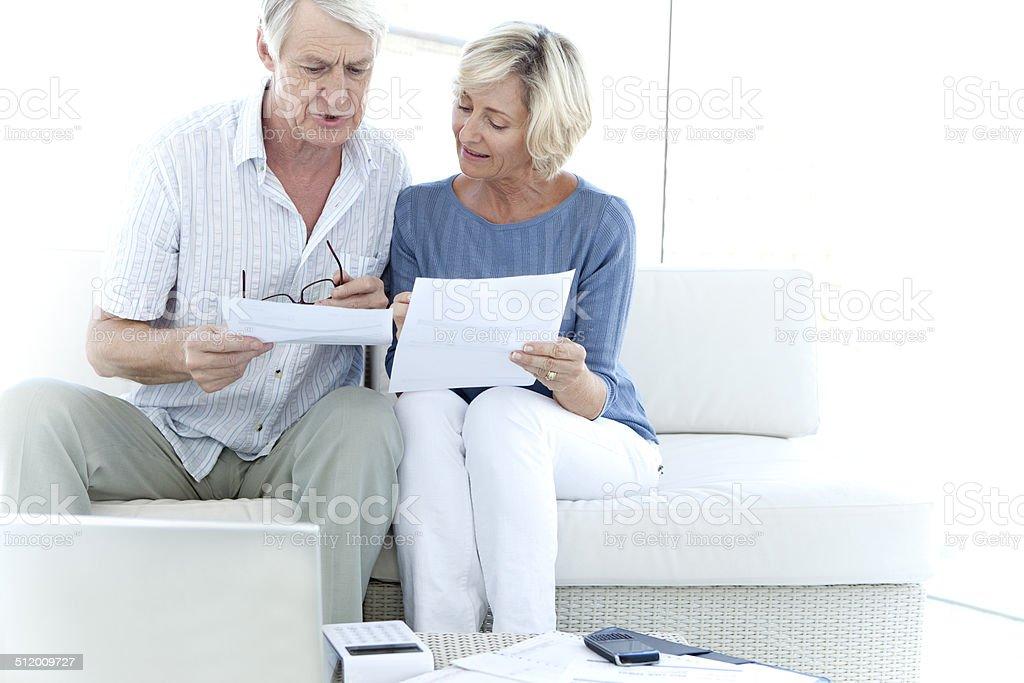 Senior adults doing home finances stock photo